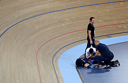 Kendall Ryan of USA receives medical attention after colliding with Marie Le Net of France (not in picture) during the Women's Madison Final during day three of the Tissot UCI Track Cycling World Cup at Lee Valley VeloPark, London.