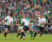 Wembley, Great Britain,  Darren CAVE, , tackled by Valentin POPARLAN, during the Pool D Game, Ireland vs Romania.  2015 Rugby World Cup, Venue, Wembley Stadium, London, ENGLAND.  Sunday  27/09/2015 <br /> <br /> Mandatory Credit; Peter Spurrier/Intersport-images]