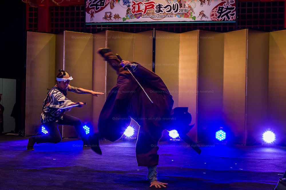 Actrors dressed as Samurai  fight during the Edo festival at Haneda International Airport terminal, Tokyo, Japan. Friday August 26th 2016. The 3 day festival runs from August 26th to August 28th at Tokyo's second International airport. Actors dressed as samurai, geisha and ninja will greet passengers and visitors to the terminal and put on shows and parades of traditional music and dance. Haneda International airport has an Edo theme. Edo is the old name for Tokyo in the time of the samurai