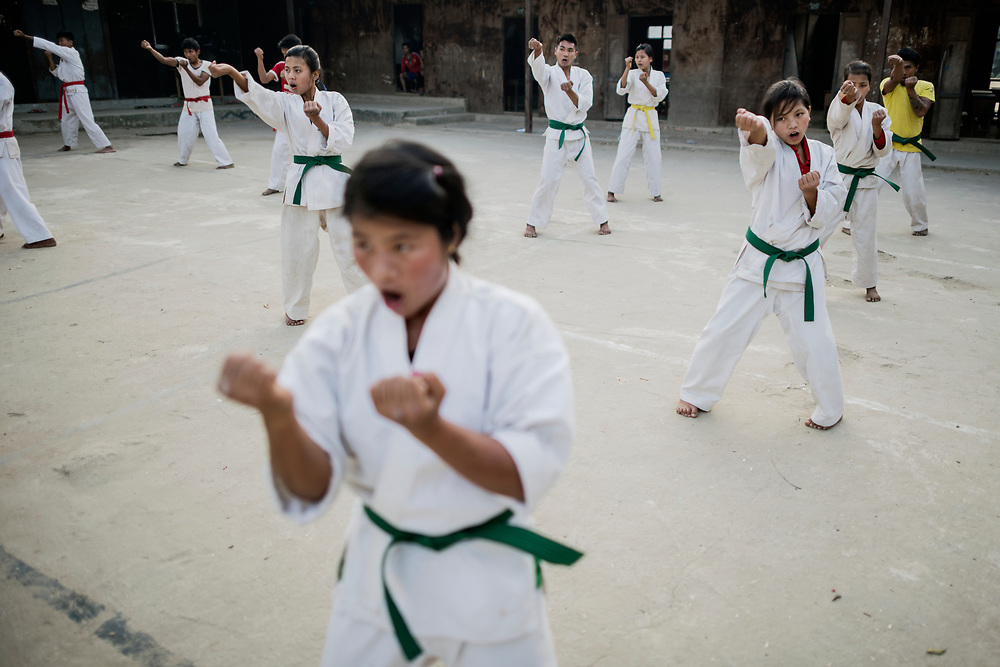 Laiza, Myanmar 20180130 <br /> Children practicing Karate after school in Je Yang IDP camp.<br /> Photo: Vilhelm Stokstad / Kontinent