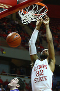 07 January 2012:  Jackie Carmichael gets the board and the put back jam during an NCAA Missouri Valley Conference mens basketball game Where the Purple Aces of Evansville lost to the Illinois State Redbirds 75-73 in Redbird Arena, Normal IL