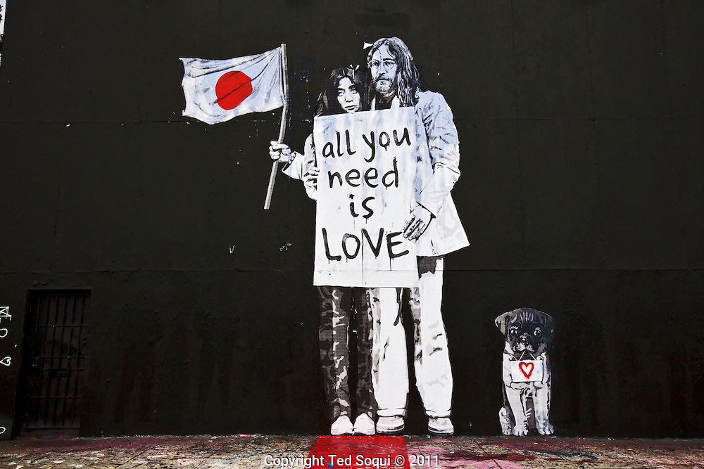 Street art in Los Angeles..L.A. has become the new ground zero for avant-guard and cutting edge street and graffiti. Artist from around the world now come to L.A. to post their work..This mural of John Lennon and Yoko Ono is on the side of Mr. Brainwash's studio located on La Brea Ave.