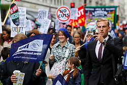 © Licensed to London News Pictures. 10/07/2014. LONDON, UK. A man takes picture of public sector workers marching from BBC Broadcasting House to Trafalgar Square in central London to protest in a series of disputes with the government over pay, pensions and cuts, with more than a million public sector workers expected to join the action across the UK. Photo credit : Tolga Akmen/LNP