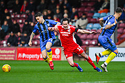 Mark Byrne of Gillingham (33) and Josh Morris of Scunthorpe United (11) come together to win the ball during the EFL Sky Bet League 1 match between Scunthorpe United and Gillingham at Glanford Park, Scunthorpe, England on 8 December 2018.