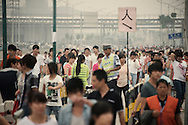Zhengzhou, June 23rd 2013<br /> At 5 pm, Foxconn workers on the day shift leave the factory.<br /> Gilles Sabrie