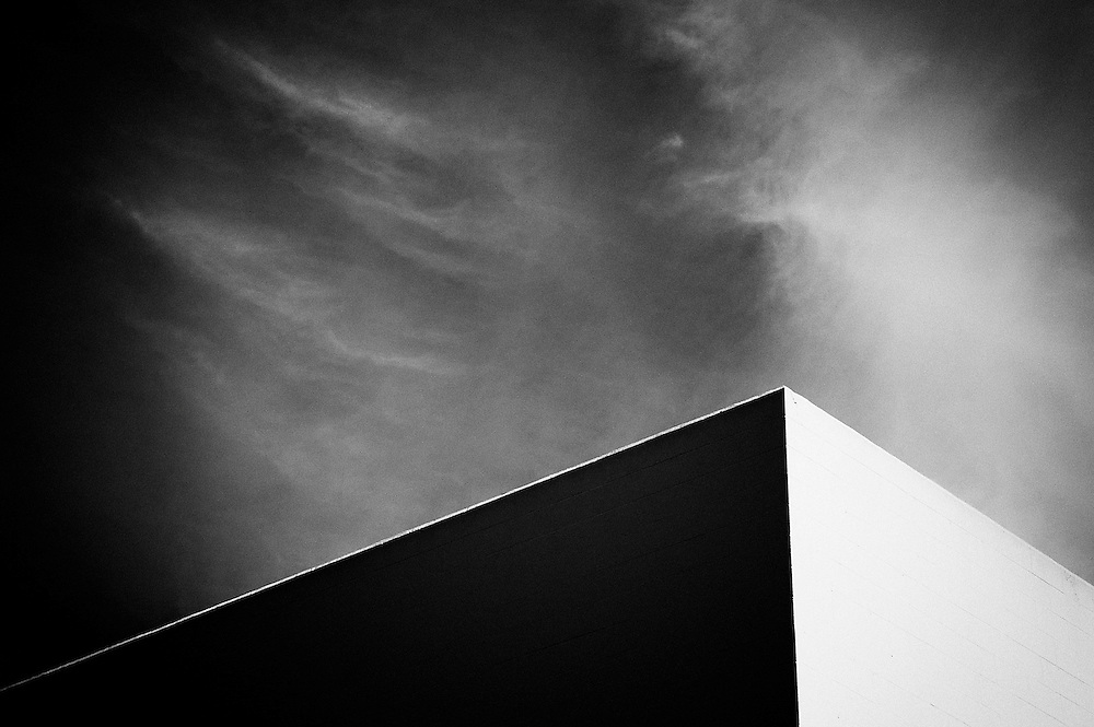 Corner of building view with sky in black & white.