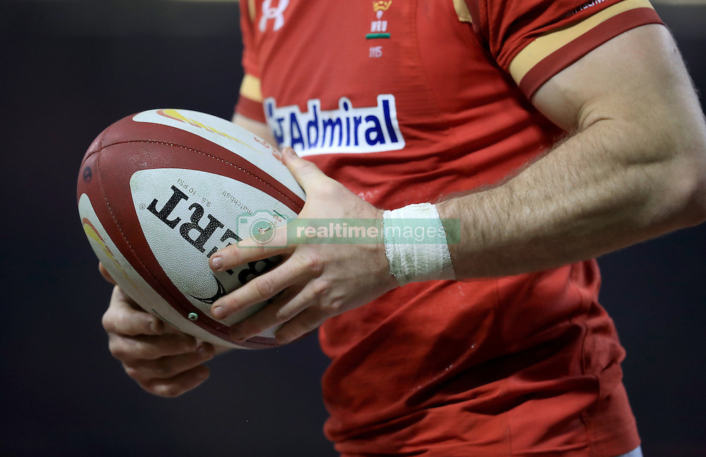 A detail view of a Wales player holding a match ball