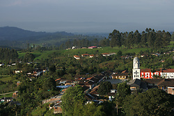An early morning view of Salento, a small town in the heart of Colombian coffee country. The tourism industry is slowly emerging in Quindio, the Colombian coffee country.  Old coffee haciendas have been turned into new hotels catering to tourists.  The countryside, some of the most beautiful in the country, is a popular weekend getaway spot where visitors can participate in a variety of outdoor activities as well as learn about coffee production.