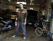 Teenager In Garage