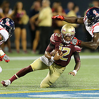 Florida State Seminoles quarterback Deondre Francois (12) slides during an NCAA football game between the Ole Miss Rebels and the Florida State Seminoles at Camping World Stadium on September 5, 2016 in Orlando, Florida. (Alex Menendez via AP)