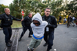 © London News Pictures. Calais, France. French police attempt to prevent an immigrant from accessing the Eurotunnel complex. Migrants attempting to reach the UK via the Eurotunnel at Calais in France. The situation has reached crisis point, which French police over run by attempts to cross the border. Photo credit: Ben Cawthra /LNP