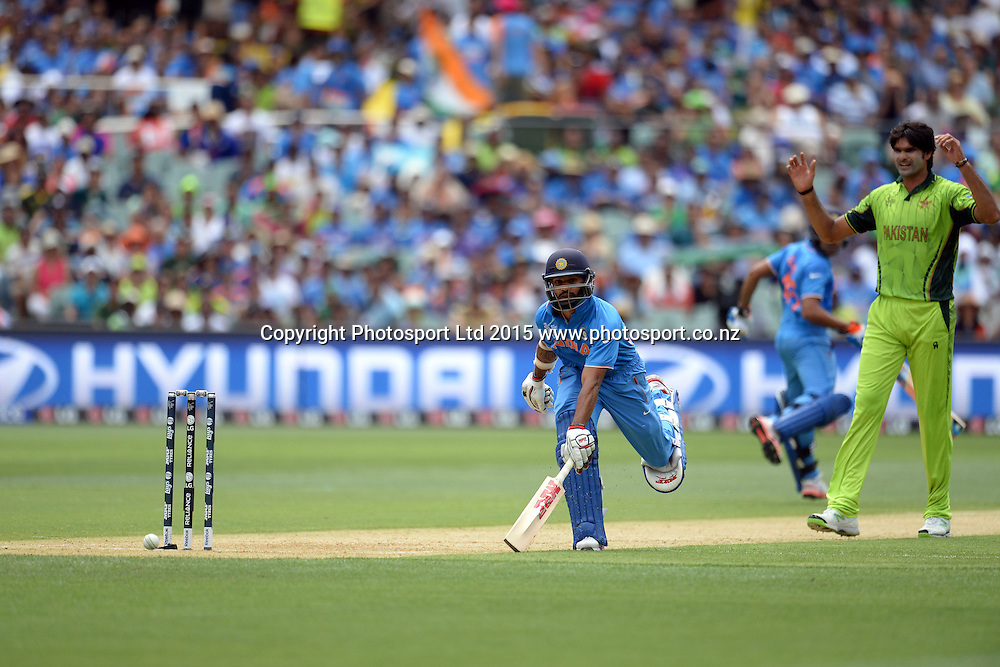 Indian batsman Shikhar Dhawan scrambles for a run during the ICC Cricket World Cup match between India and Pakistan at Adelaide Oval in Adelaide, Australia. Sunday 15 February 2015. Copyright Photo: Raghavan Venugopal / www.photosport.co.nz