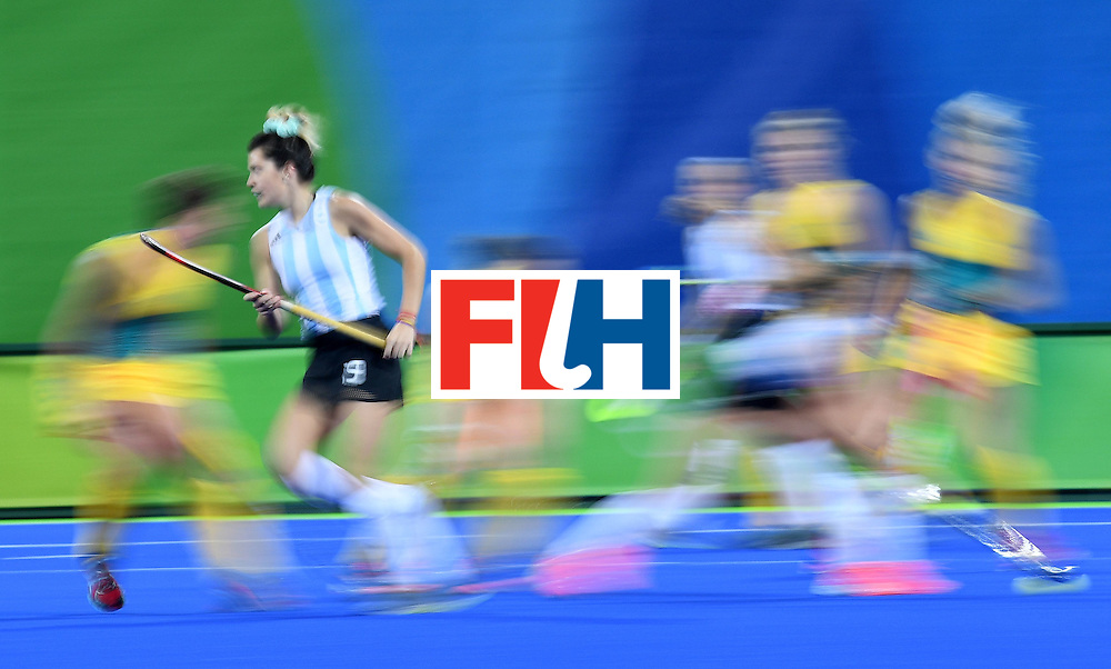 Argentina's Agustina Albertarrio (2L) runs during the women's field hockey Australia vs Argentina match of the Rio 2016 Olympics Games at the Olympic Hockey Centre in Rio de Janeiro on August, 11 2016. / AFP / MANAN VATSYAYANA        (Photo credit should read MANAN VATSYAYANA/AFP/Getty Images)