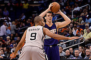 Oct 16, 2014; Phoenix, AZ, USA; Phoenix Suns guard Goran Dragic (1) handles the ball against the San Antonio Spurs guard Tony Parker (9) in the first half at US Airways Center. Mandatory Credit: Jennifer Stewart-USA TODAY Sports