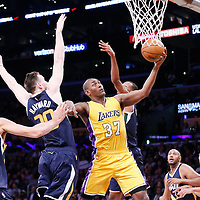 05 December 2016: Los Angeles Lakers forward Metta World Peace (37) goes for the layup past Utah Jazz center Rudy Gobert (27), Utah Jazz forward Gordon Hayward (20) and Utah Jazz guard Rodney Hood (5) during the Utah Jazz 107-101 victory over the Los Angeles Lakers, at the Staples Center, Los Angeles, California, USA.