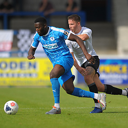 TELFORD COPYRIGHT MIKE SHERIDAN Zak Lilly of Telford chases down Akwasi Asante during the National League North fixture between AFC Telford United and Chester FC at the New Bucks Head on Saturday, September 14, 2019<br /> <br /> Picture credit: Mike Sheridan<br /> <br /> MS201920-018