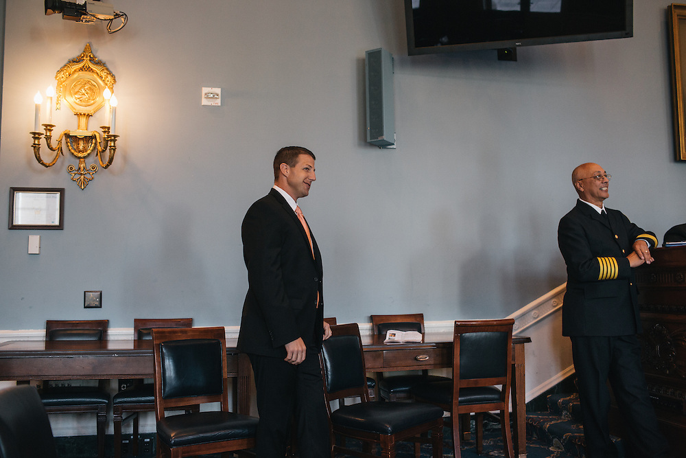 Congressman Markwayne Mullin  waits to speak to a group of Oklahoma Fire Marshals near the U.S. Capitol on Sept. 19, 2013.