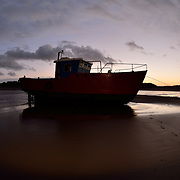 Little red boat blue with a little light in the window.<br />
