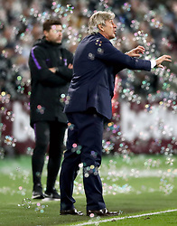 West Ham United manager Manuel Pellegrini reacts to bubbles blown on to the pitch during the Carabao Cup, Fourth Round match at the London Stadium.