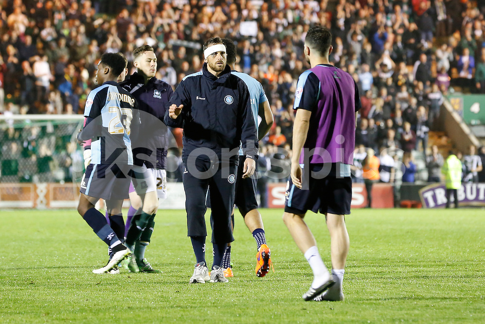 A bandaged and black-eyed Wycombe captain Paul Hayes congratulates his players at the end of the Sky Bet League 2 Play Off 1st Leg match between Plymouth Argyle and Wycombe Wanderers at Home Park, Plymouth, England on 9 May 2015. Photo by Mark Hawkins.