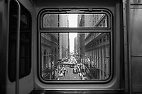 A Brown Line train window frames a view of Adams Street and the Art Institute of Chicago in Chicago's famous &quot;Loop,&quot; so named for the elevated tracks that encircle the area. <br />