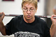 Elaine Kaminski of Chili does squats during a class at CrossFit Chili on Scottsville Road in Rochester on Thursday, October 30, 2014.