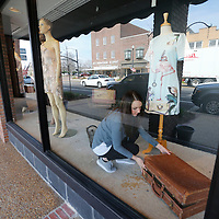 THOMAS WELLS | BUY at PHOTOS.DJOURNAL.COM<br /> Jessica begins setting up her design as motorist pass by the window on Main Street.
