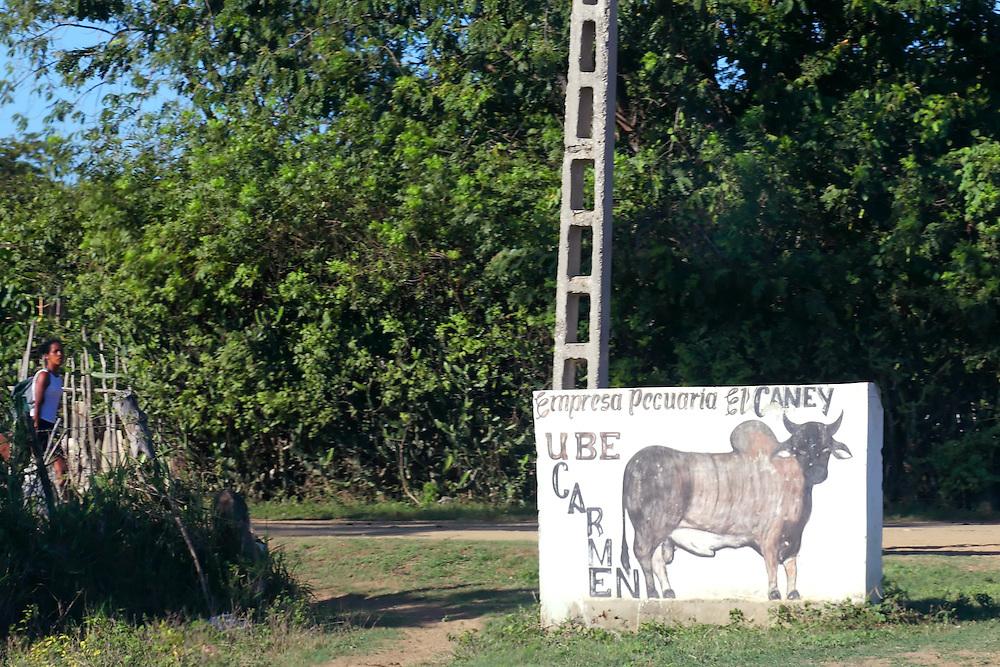 Farm sign on the south coast road from Santiago de Cuba to Pilon.