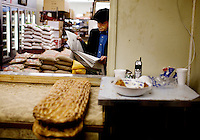A man waits for his order of naan, at the Maiwand Market, in Fremont, Ca., on Saturday, March 7, 2009.