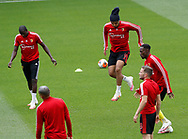 Abdoulaye Doucoure, Troy Deeney and Danny Welbeck of Watford  warm up before the Premier League match at Vicarage Road, Watford. Picture date: 20th June 2020. Picture credit should read: Darren Staples/Sportimage
