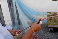 Anzio, Italy, 11/09/2009: Antonio, un tempo pescatore, da anni lavora sulla banchina del porto preparando le reti per la barche della piccola pesca<br /> &copy;Andrea Sabbadini