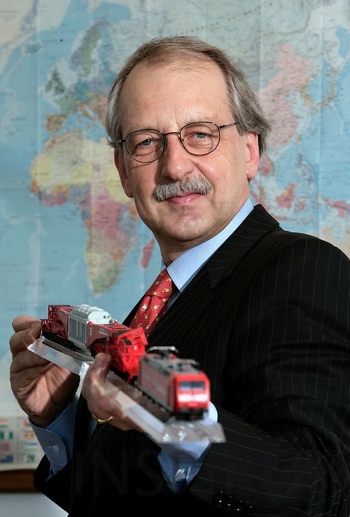 BRUSSELS - BELGIUM - 05 MARCH 2007 -- Matthias RUETE, Director General DG Energy and Transports holding a model of a train.   PHOTO: ERIK LUNTANG