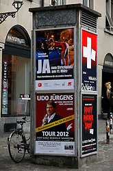 SWITZERLAND ZURICH 3MAR12 - Advertising pillar in Zurich city centre, Switzerland. ..One of the posters proposes a designated area for prostitution in Zurich city centre, supported by the liberal, green and various other political parties of Switzerland...jre/Photo by Jiri Rezac....© Jiri Rezac 2012