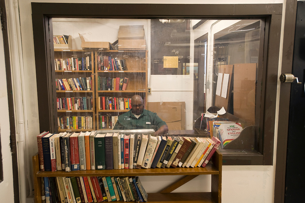 "Inmate and Bard College student Stacey C. Williams studies in the library at Woodbourne Correctional Facility. Stacey has been sentenced to 10 years of which he has spent 6. He graduated from Bard with  Bachelor of Art (BA) in June 2010...Story: The Bard Prison Initiative.Former inmate Carlos Rosario, 35-year-old husband and father of four, was released from Woodbourne Correctional Facility after serving more than 12 years for armed robbery. Rosado is one of the students participating in the Bard Prison Initiative, a privately-funded program that offers inmates at five New York State prisons the opportunity to work toward a college degree from Bard College. The program, which is the brainchild of alumnus Max Kenner, is competitive, accepting only 15 new students at each facility every other year. .Carlos Rosario received the Bachelor of Arts degree in social studies from the prestigious College Saturday, just a few days after his release. He had been working on it for the last six years. His senior thesis was titled ""The Diet of Punishment: Prison Food and Penal Practice in the Post-Rehabilitative Era,"".Rosado is credited with developing a garden in one of the few green spaces inside the otherwise cement-heavy prison. In the two years since the garden's foundation, it has provided some of the only access the prison's 800 inmates have to fresh vegetables and fruit...Rosario now works for a recycling company in Poughkeepsie, N.Y...Photo © Stefan Falke"