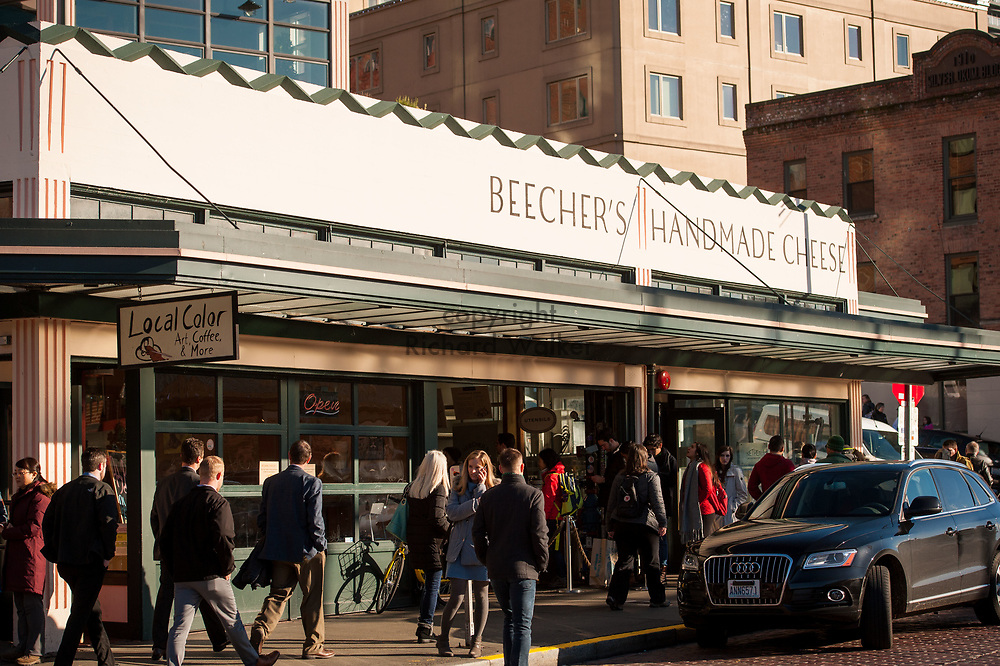 2017 DECEMBER 05 - People walk past Beecher's Handmade Cheese at Pike Place Market, Seattle, WA, USA. By Richard Walker