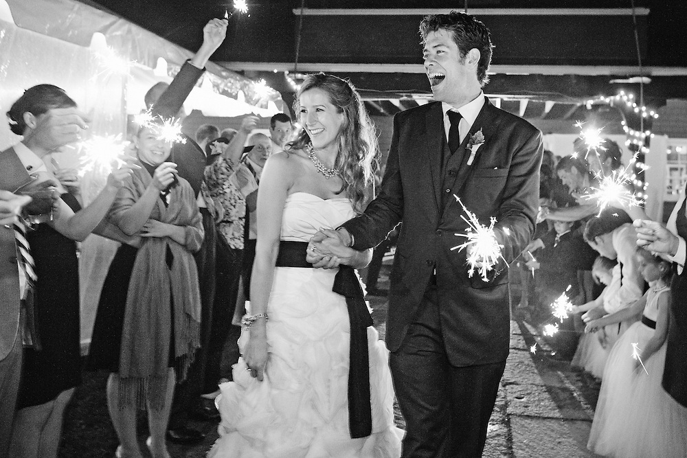 A sparkler exit at a Maine wedding at the Camden Yacht Club.  Image by Maine Wedding Photographer Michelle Turner.