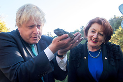 Britain's Foreign Secretary Boris Johnson, left, holds a Tuatara lizard at Zealandia with Minister of the Environment Maggie Barry in  Wellington, New Zealand on July 24, 2017. Credit:SNPA / Marty Melville  AFP POOL