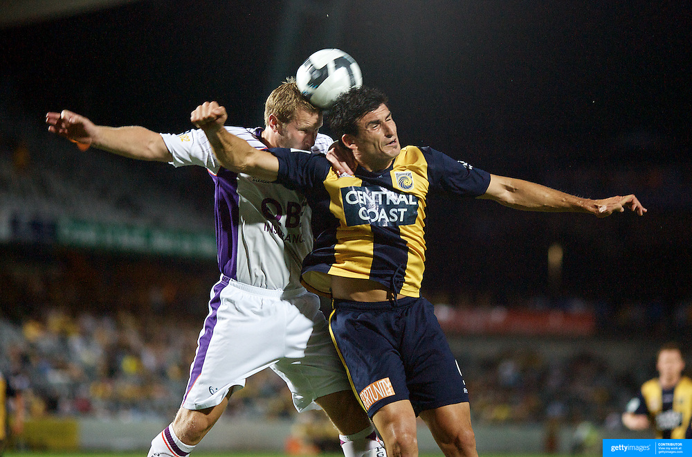 Andy Todd wins the header from Nick Mrdja  during the Central Coast Mariners V Perth Glory A-League match at Gosford, New South Wales, Australia, on Friday, November 27, 2009. Photo Tim Clayton.