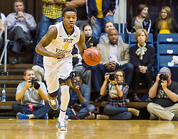 Nov 13, 2015; Morgantown, WV, USA; West Virginia Mountaineers guard Daxter Miles Jr. dribbles the ball up the floor during the first half against the Northern Kentucky Norse at WVU Coliseum. Mandatory Credit: Ben Queen-USA TODAY Sports
