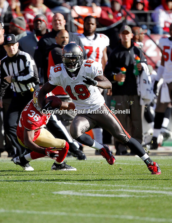 Tampa Bay Buccaneers wide receiver Mike Williams (19) runs with the ball after catching a pass and dodging a tackle attempt by San Francisco 49ers cornerback Shawntae Spencer (36) during the NFL week 11 football game against the San Francisco 49ers on Sunday, November 21, 2010 in San Francisco, California. The Bucs won the game 21-0. (©Paul Anthony Spinelli)