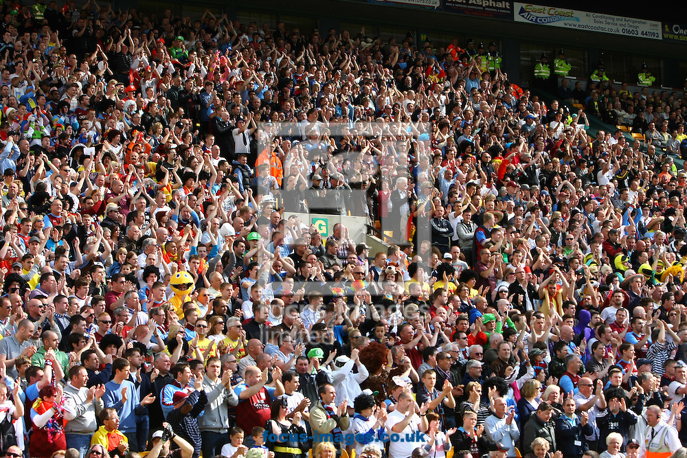 Picture by Paul Chesterton/Focus Images Ltd.  07904 640267.13/05/12.The Norwich fans join in the applause on the 19th minute for Stiliyan Petrov of Aston Villa during the Barclays Premier League match at Carrow Road Stadium, Norwich.