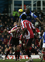 Photo: Lee Earle.<br /> Portsmouth v Sheffield United. The Barclays Premiership. 23/12/2006. Portsmouth's Noe Pamarot (R) scores their third.