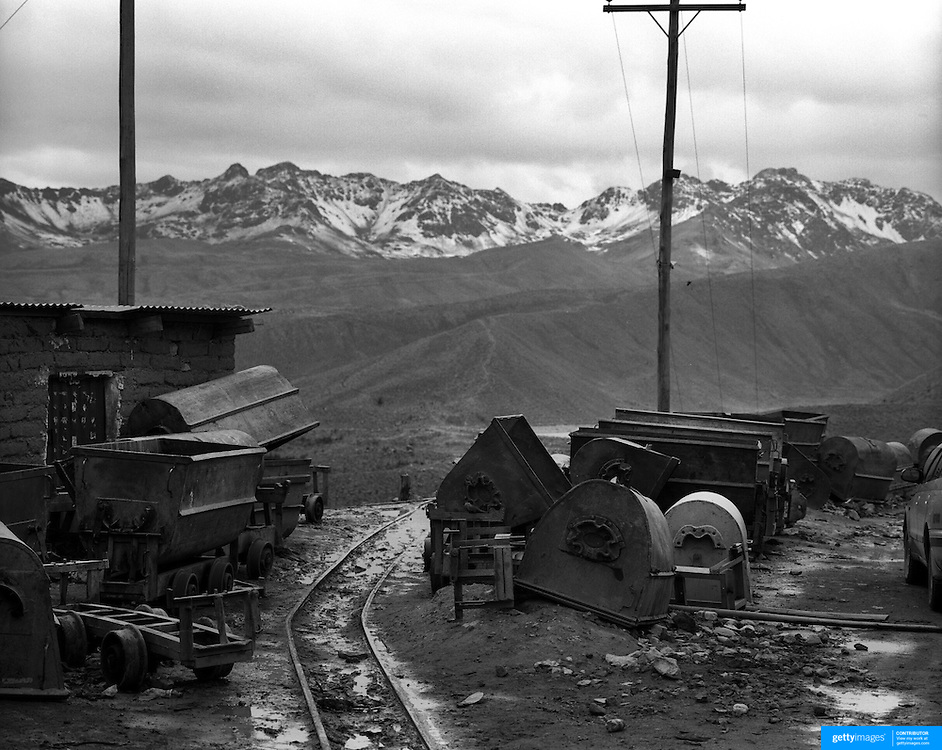 Mining equipment on the infamous mountain, Cerro Rico (rich mountain) overlooking the City of Potosi. Bolivia..Sitting at 4,090M (13,420 Feet) above sea level the small mining community of Potosi, Bolivia is one of the highest cities in the world by elevation and sits ?sky high? in the hills of the land locked nation. Overlooking the city is the infamous mountain, Cerro Rico (rich mountain), a mountain conceived to be made of silver ore. It was the major supplier of silver for the spanish empire and has been mined since 1546, according to records 45,000 tons of pure silver were mined from Cerro Rico between 1556 and 1783, 9000 tons of which went to the Spanish Monarchy. The mountain produced fabulous wealth and became one of the largest and wealthiest cities in Latin America. The Extraordinary riches of Potosi were featured in Maguel de Cervantes famous novel Don Quixote. One theory holds that the mint mark of Potosi, the letters PTSI superimposed on one another is the origin of the dollar sign. Today mainly zinc, lead, tin and small quantities of silver are extracted from the mine by over 100 co-operatives and private mining companies who still mine the mountain in poor working conditions, children are still used in the mines and the lack of protective equipment and constant inhalation of dust means miners have a short life expectancy with many contracting silicosis and dying around 40 years of age. UNESCO designated the historic city a World Heritage site in 1987. Most of Potosí's colonial churches have been restored, and tourism has increased. Potosi, Bolivia. 16th September 2011. Photo Tim Clayton