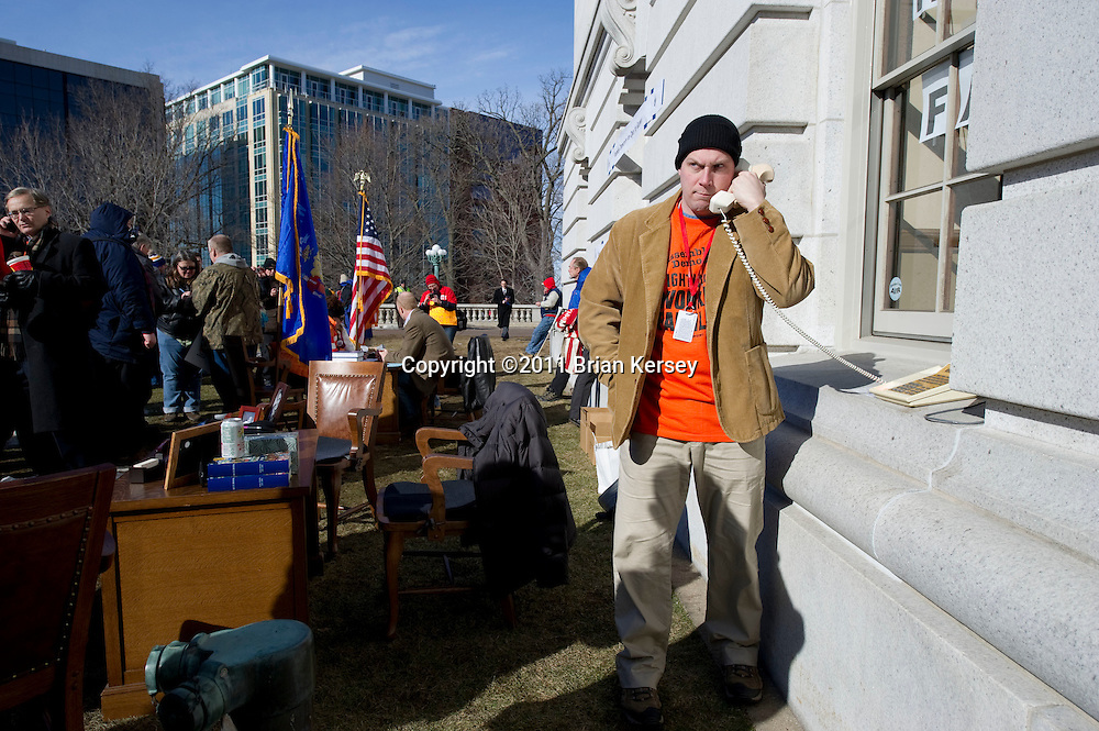 Democratic State Rep. Nick Milroy talks on the phone outside of his office at the state Capitol on March 2, 2011 in Madison, Wisconsin. Four Democratic assembly members set up offices outside the building, claiming that restrictions on entry to the state Capitol prevented the public from having sufficient access to their representatives.         (Photo by Brian Kersey)