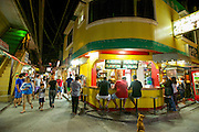 Tourists enjoy dinner in one of the outdoor eateries in Sabang village, Puerto Galera.