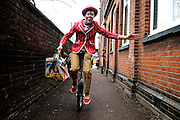 A clown performs as he arrives at The Clown's Service on 7th February 2010. The first Sunday in February is the annual clowns church service at Holy Trinity Church in Dalston, east London. Clowns attend a church service in memory of the clown Joseph Grimaldi. The clowns usually perform for the public after the church service. © under license to London News Pictures.