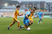 Danny McNamara and Joss Labadie foul Chris Hussey during the EFL Sky Bet League 2 match between Newport County and Cheltenham Town at Rodney Parade, Newport, Wales on 1 January 2020.