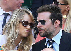 Image licensed to i-Images Picture Agency. 04/07/2014. London, United Kingdom.  Suki Waterhouse  and Bradley Cooper  in the Royal box  on day eleven of the Wimbledon Tennis Championships . Picture by Stephen Lock / i-Images