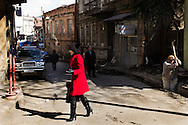 Tbilisi, Georgia - 25 marzo 2012. Una donna passeggia lungo le strade del centro di Tbilisi..Ph. Roberto Salomone Ag. Controluce.GEORGIA - A woman walks in downtown Tbilisi on February 25, 2012.