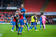 Jordan White (#19) of Inverness Caledonian Thistle FC celebrates with Shaun Rooney (#2) of Inverness Caledonian Thistle FC at the final whistle of the William Hill Scottish Cup quarter final match between Dundee United and Inverness CT at Tannadice Park, Dundee, Scotland on 3 March 2019.